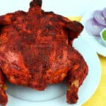 whole chicken tandoori with green chutney and sliced onions
