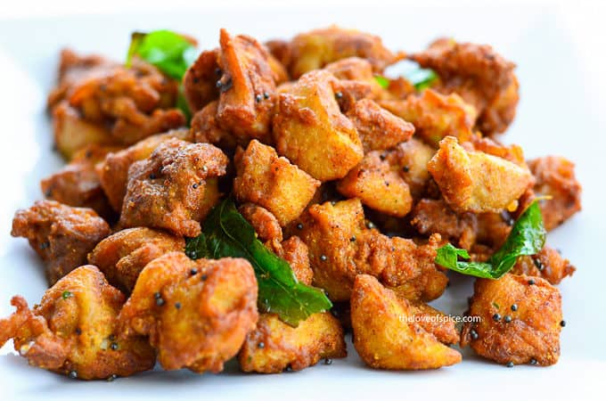 indian spiced deep fried boneless chicken pieces tempered with mustard seeds and curry leaves