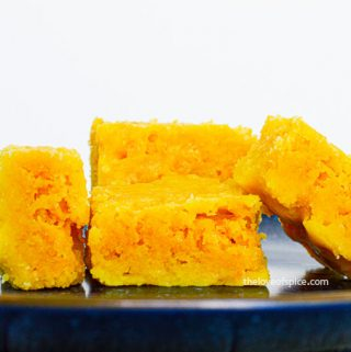 4 pieces of mysore pak on a blue plate