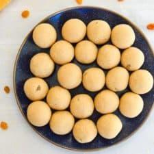 blue plate full of churmundo ladoos