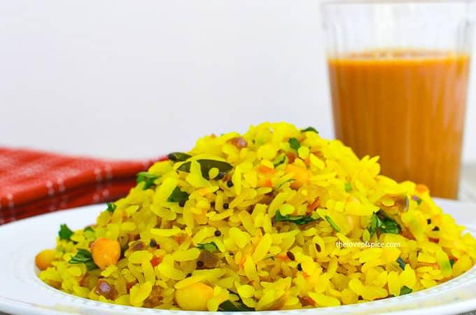 a plate kanda poha with adrak chai