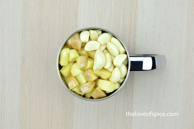 ginger cubes and garlic cloves in a mixer jar