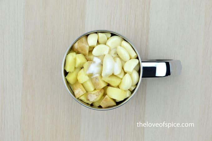 ginger cubes, garlic cloves, oil and salt in a mixer jar