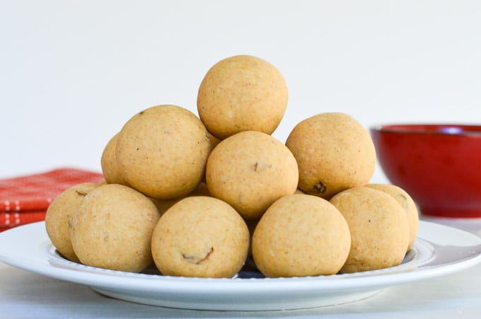 churma ladoos or wheat flour ladoos  placed in a plate, stacked on top of each other