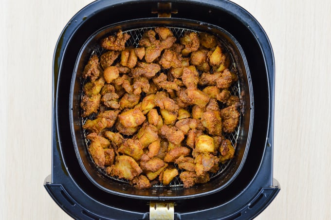 indian style fried chicken bites inside phillips airfryer basket