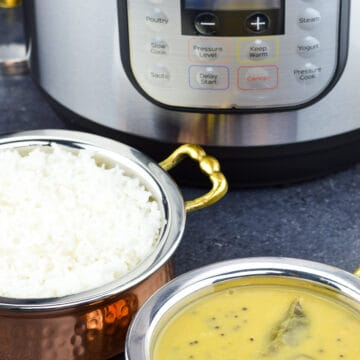 a close up shot of a kadai of rice and a smaller kadai of dal with instant pot in the background