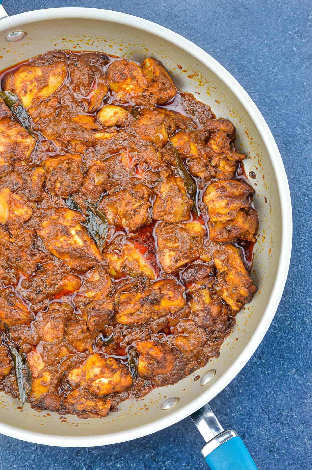 top shot of ghee roast chicken in a pan