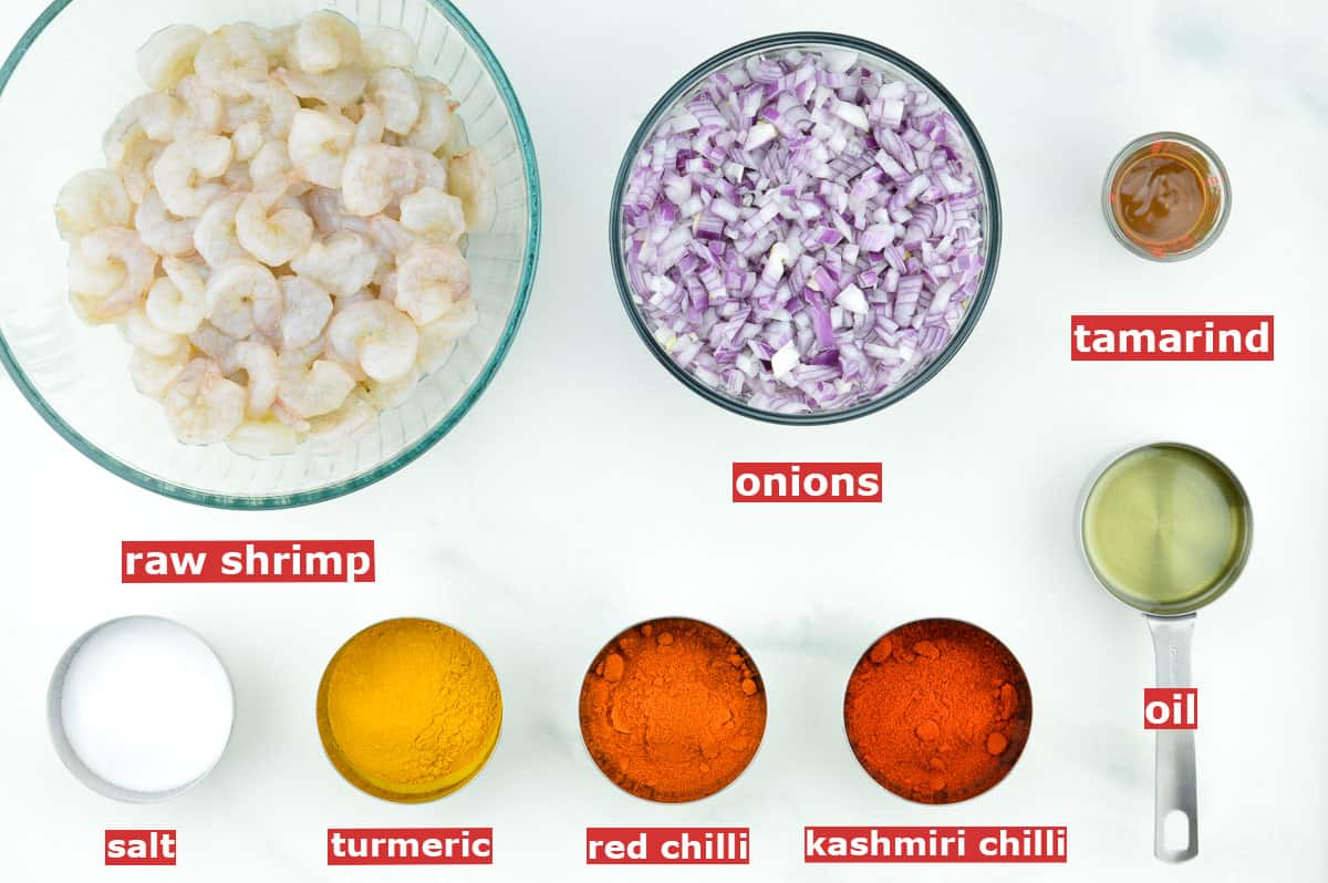 top shot of all the ingredients required to make spicy Indian prawn curry