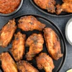 platters of tandoori chicken wings served with dipping sauces on the side