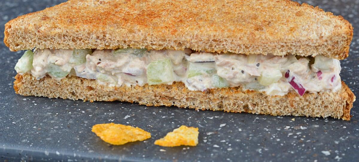 close up shot of half of a tuna sandwich
