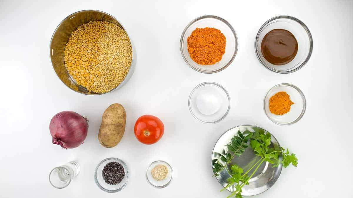 top shot of all the ingredients required to make a basic south indian sambar